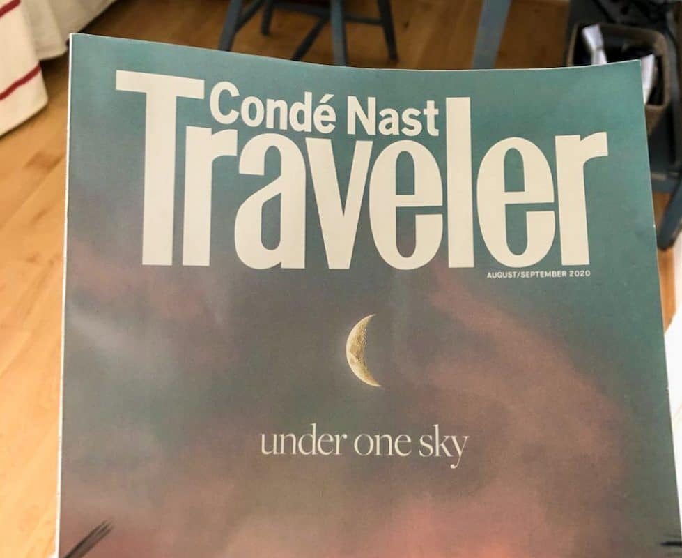 reading conde nast traveler at home