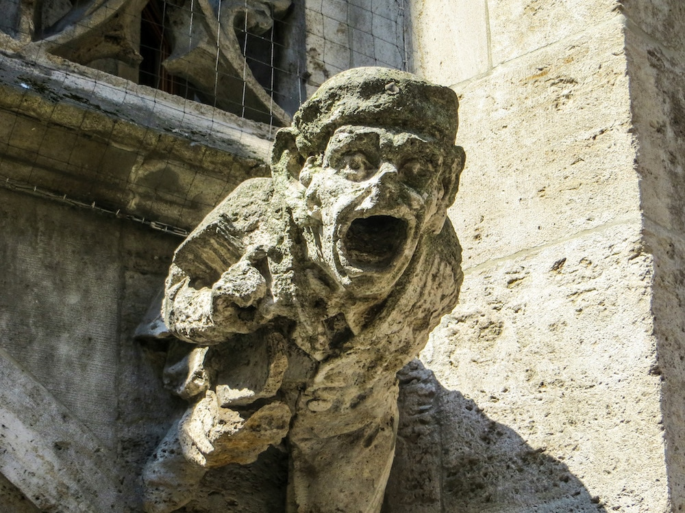 taking photos of gargoyles is a one of the fun things to do alone in munich
