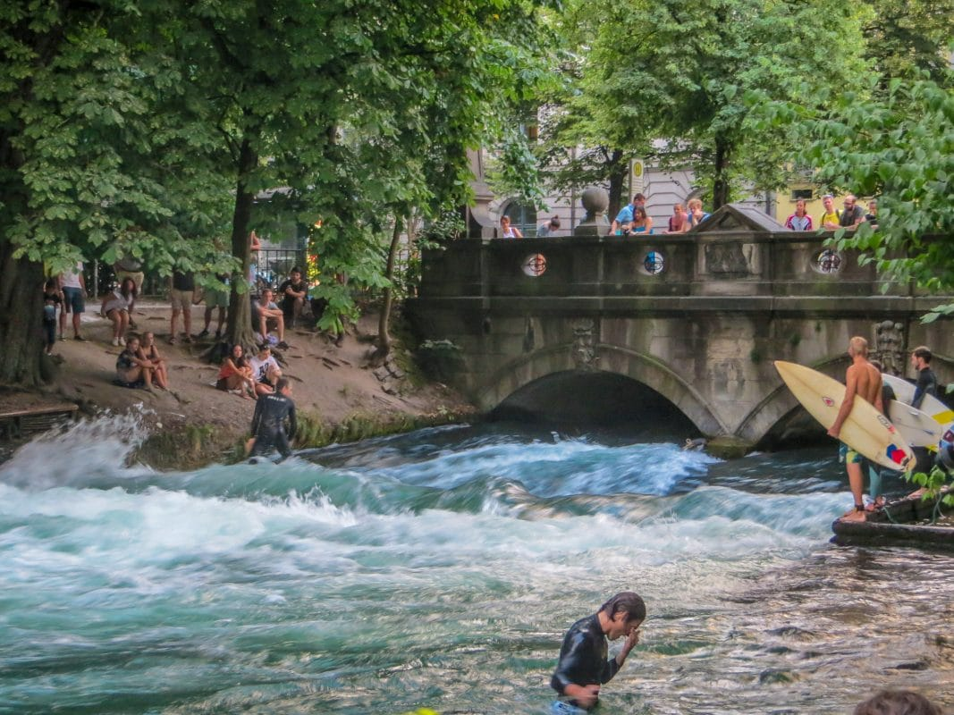 checking out surfers is one of the best things to do alone in munich