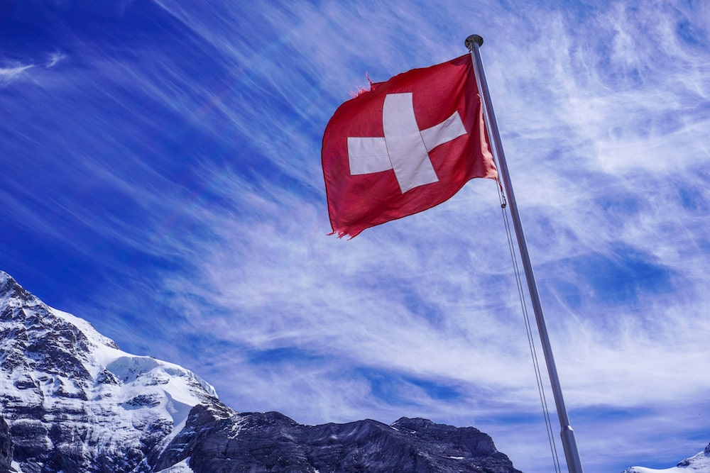 lovely swiss flag in the mountains